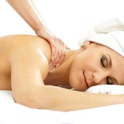 woman-with-towel-around-head-getting-back-massage